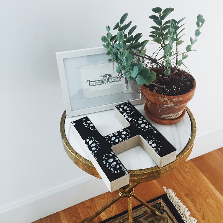 Urban Outfitters apartment Arrow Side Table, Plum & Bow Batik decorative letter