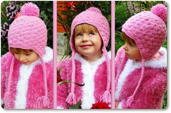 Gorro rosa con  pompón y trenzas al crochet