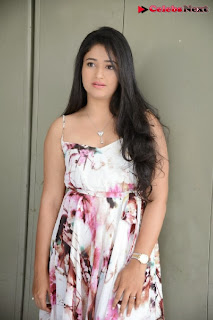 Actress Poonam Bajwa Pictures in Floral Dress at Gulf Andhra Music Awards 2013 Press Meet  0015.jpg
