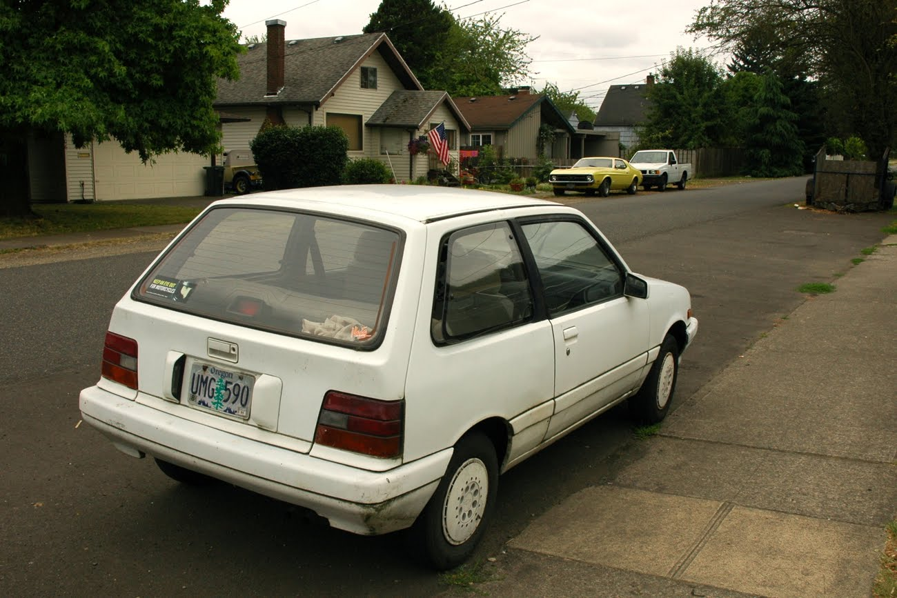 OLD PARKED CARS.: 1988 Chevy Sprint.