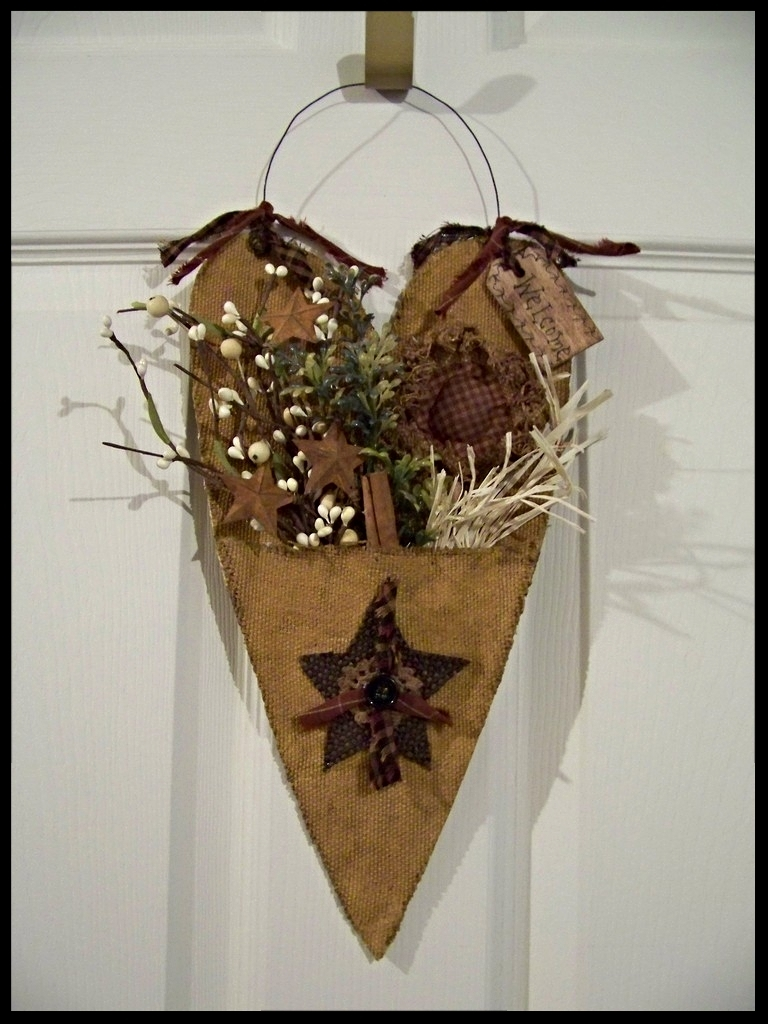 Primitive Welcome Heart 13 1/2 inches tall not counting the hanger