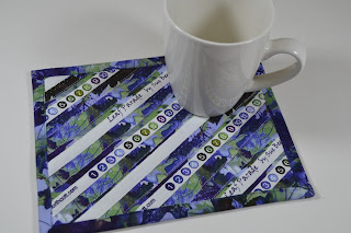 https://www.etsy.com/listing/224986833/upcycled-mug-rug-blue-patchwork-selvage