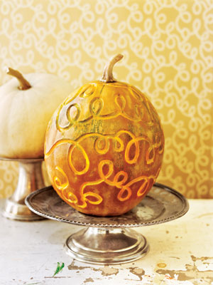 Disguise your pumpkin with a vintage as shown or new Halloween mask