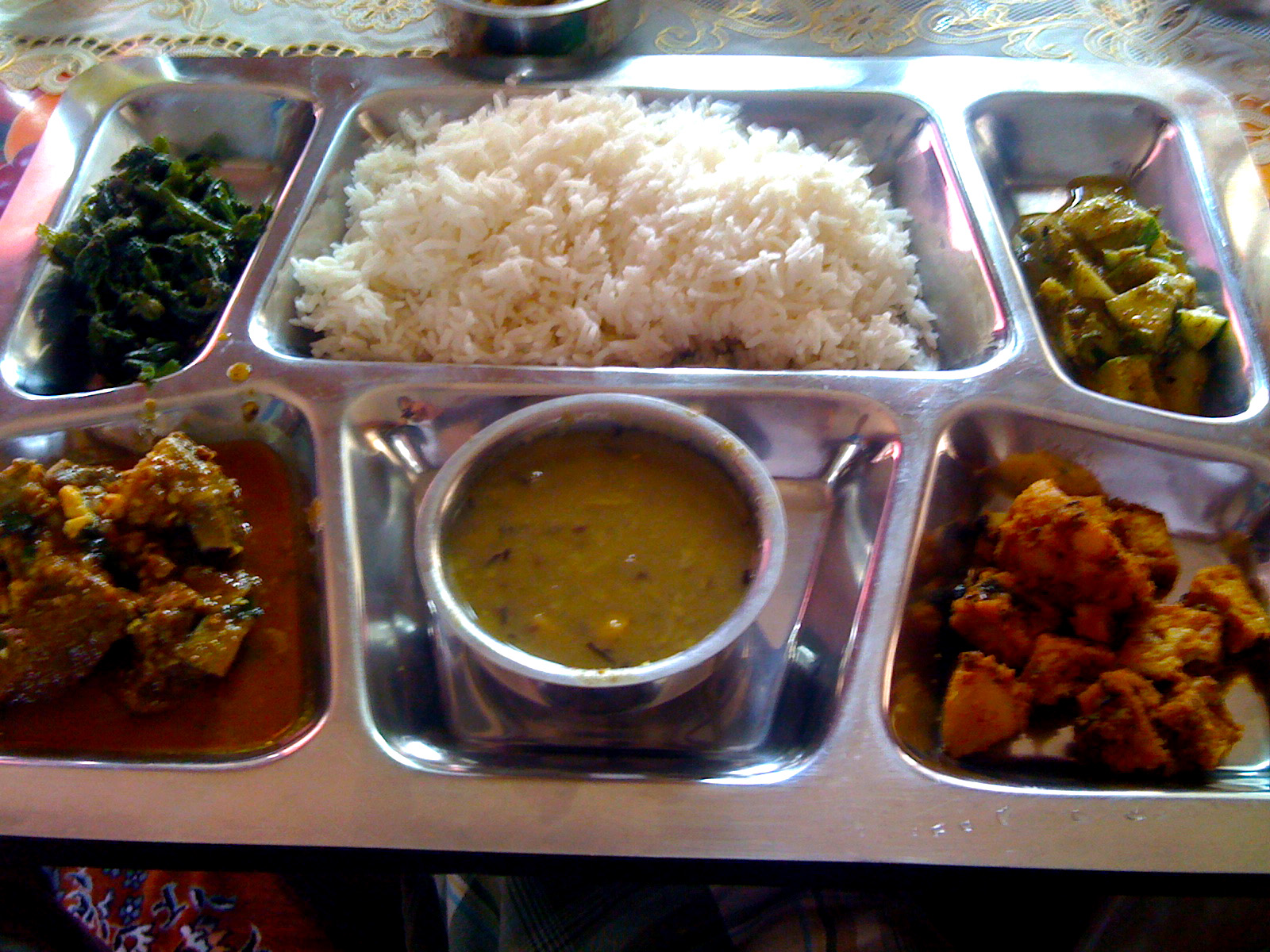 Traditional Nepali Thali - Mustard Green, Goat Curry, Lentils, paneer ...