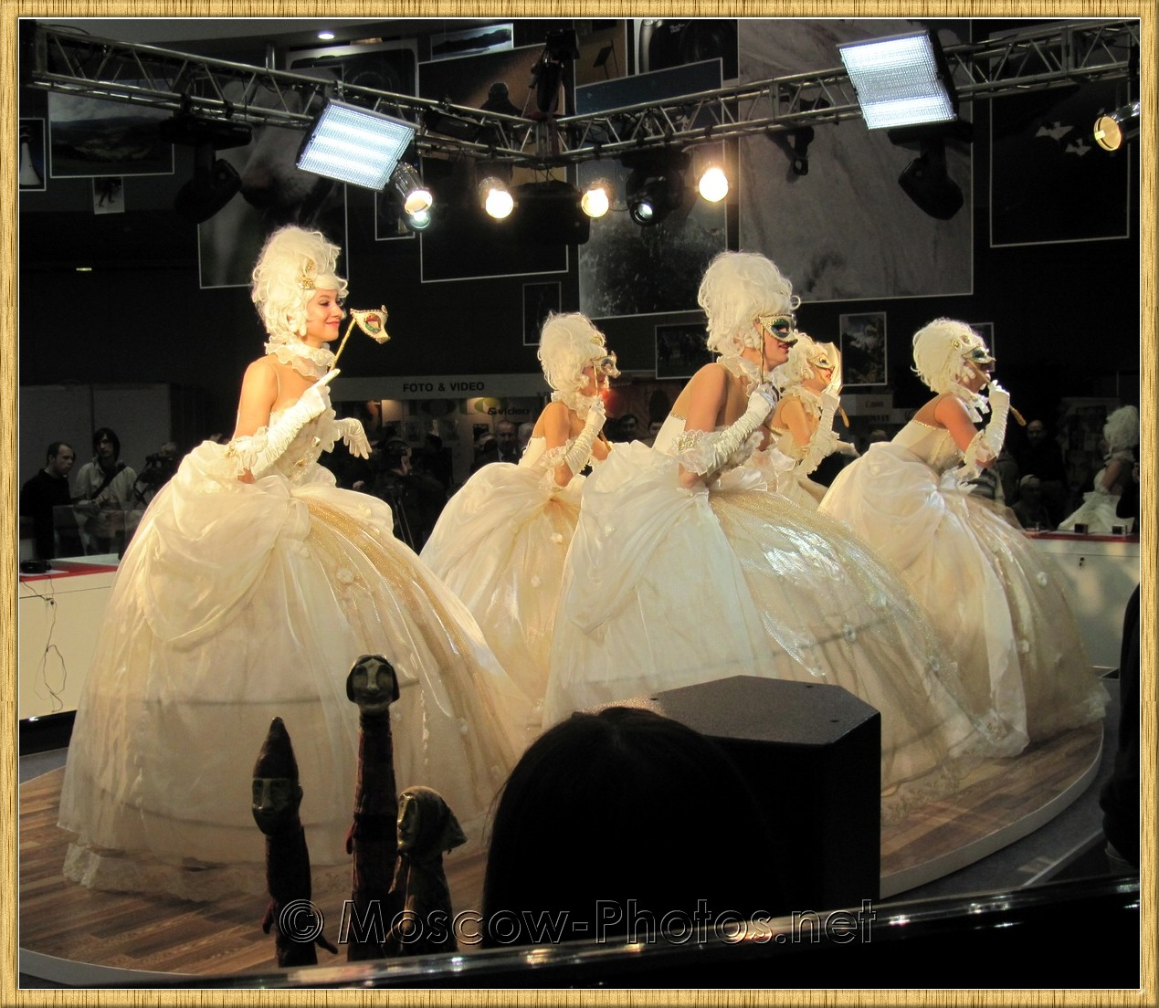 Dancing girls in white ball gowns at Photoforum 2010