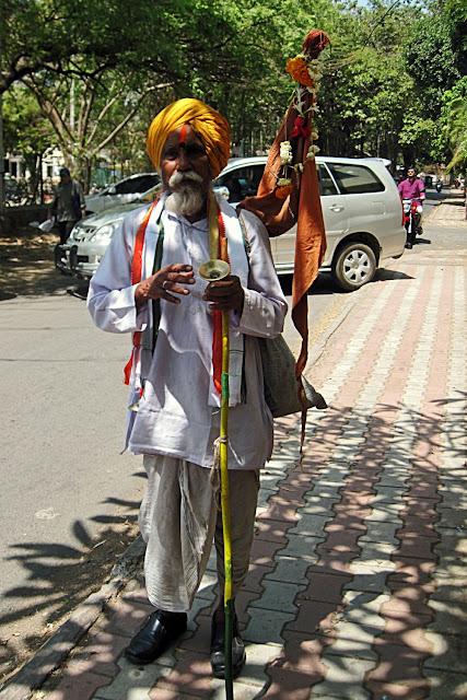 old man hindu devotee singing