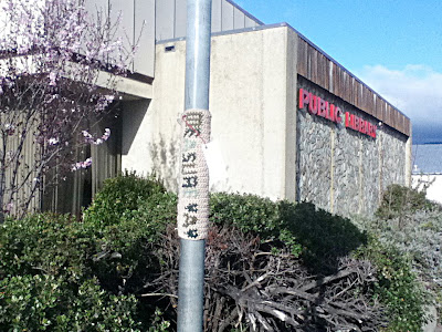 """Measure Yay."" Yarnbombing tag at Ukiah library"