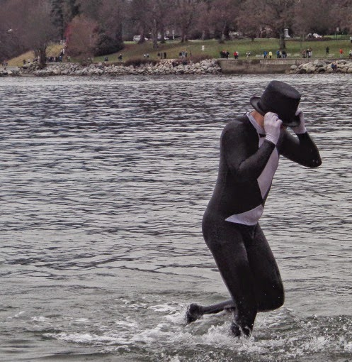 A man with black top hat escaping the waters