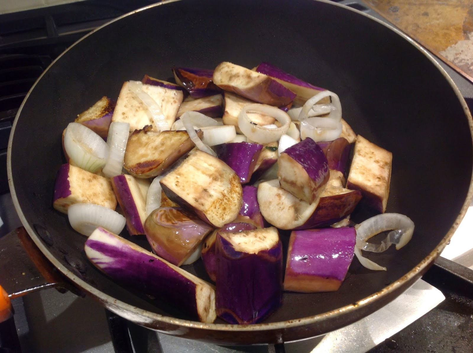 eggplant cooking in pan