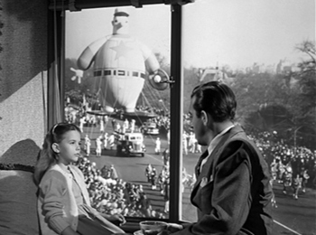 Fred and Susan talking in front of the Macy's Thanksgiving Day Parade