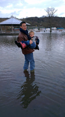 Man and boy in flooded river