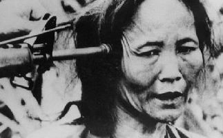 My Lai pointing gun elderly vietnamese woman