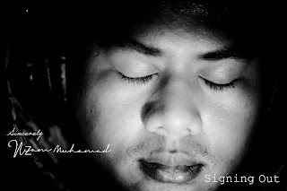 Nizam Muhamad closed eyes while listening to music with a audio technica headphone