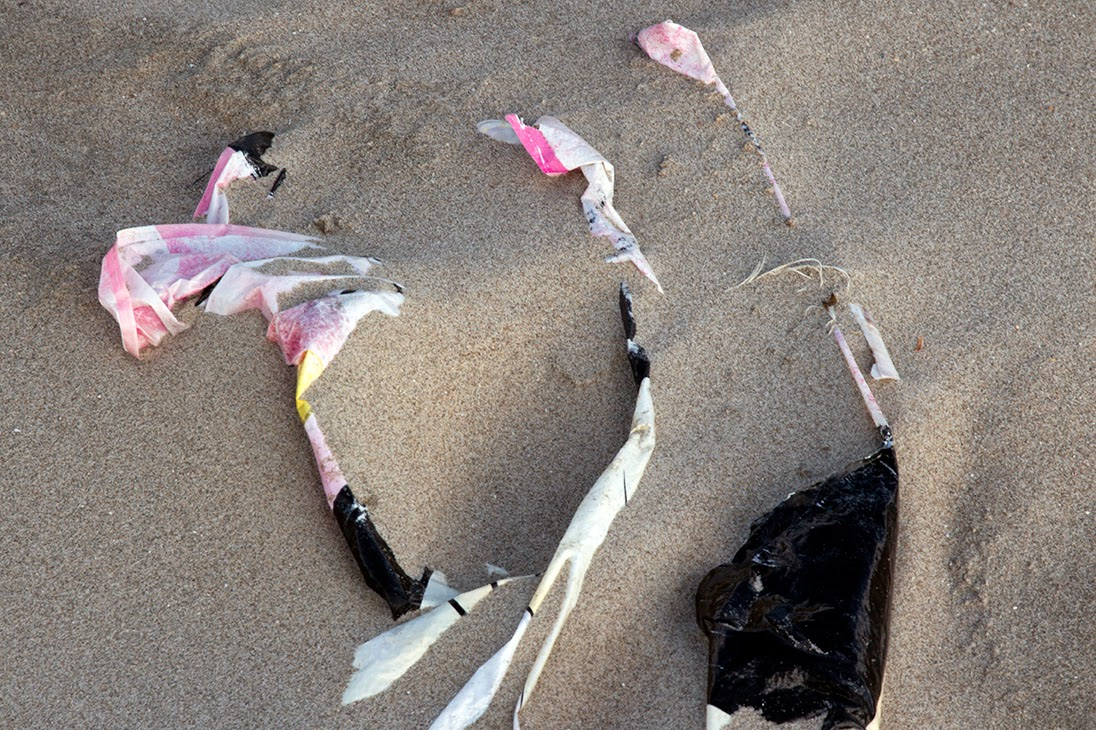 pink plastic in sand
