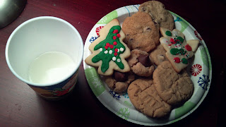 christmas cookies and milk set out for santa