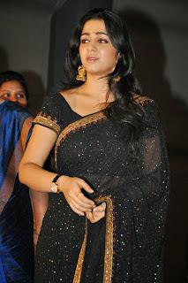 Charmi in Black saree looks beautiful at jyothilakshmi trailer launch