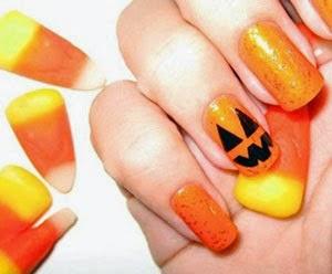 uñas naranjas con calabazas