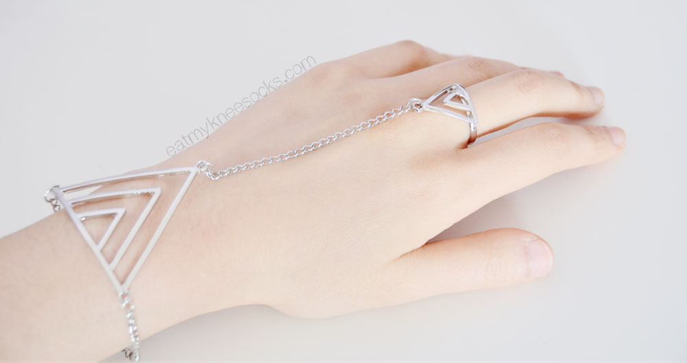The minimalist silver triangle hand chain from Born Pretty Store, as modeled.