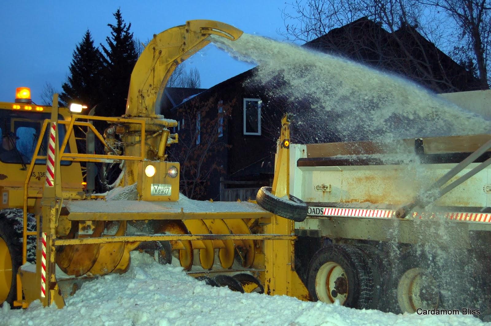 Grinding blades churn rocky, icy snow into fine powder