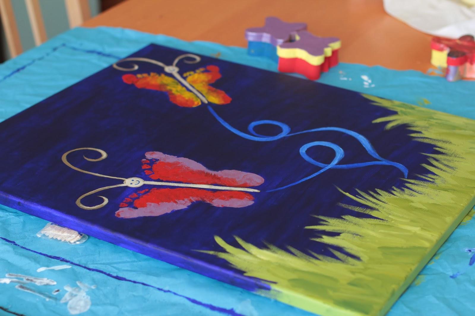 a little melissa wall art with kids butterfly footprint paintings