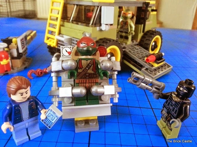 LEGO TMNT Turtle Van Takedown Set 79115 Review scene turtle imprisoned in stretcher