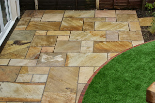 Natural stone paving installed by skilled landscapers