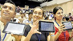Students displaying the Worlds cheapest Tablet PC Ubislate