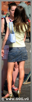 Girl in denim skirt on the street