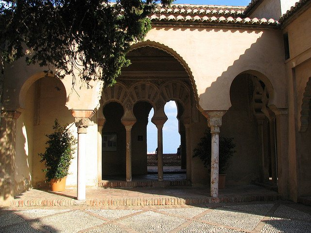 Intricately designed and carved Moorish arches can be found throughout Alcazaba. Photo: Cyberfrancis. Unauthorized use is prohibited.