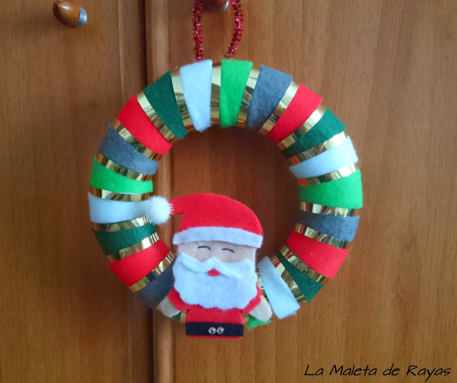 Decorar puerta navidena aprender manualidades es for Materiales para manualidades navidenas