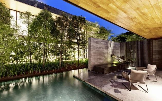 Rumah unik dengan taman di atas atap