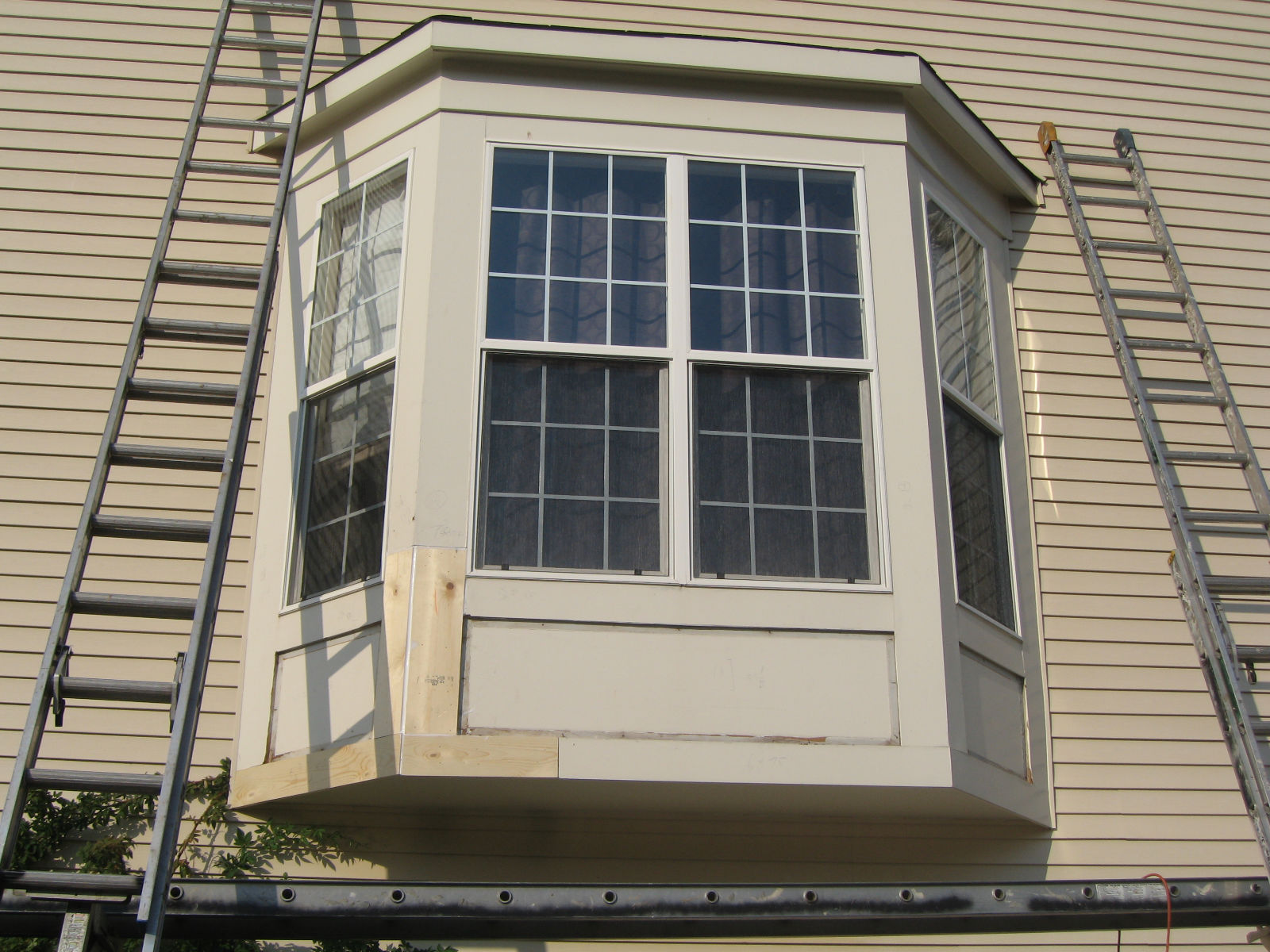 Bfc inc bay window capping wood replace for Bay window replacement windows