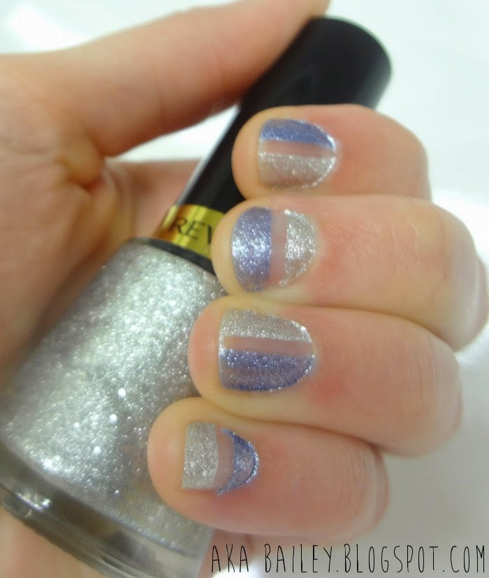 Negative space mani using blue glitter nail polish and silver glitter nail polish