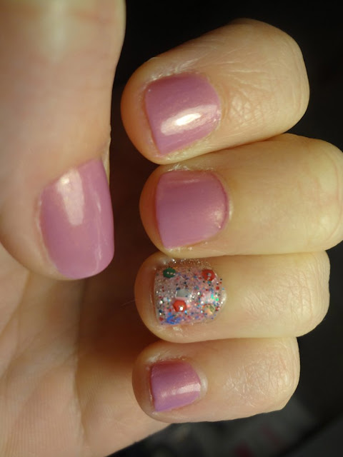 orchid nail polish with lollipop accent nail
