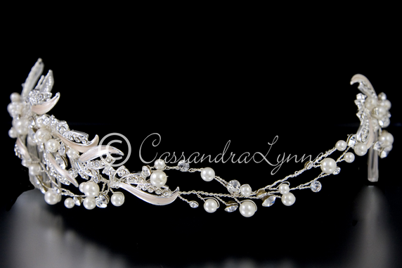 http://cassandralynne.com/collections/wedding-headbands/products/wedding-headband-or-back-piece-rum-pink-accents-and-pearls