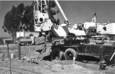 Truck-mounted auger drill rig used to excavate piers.