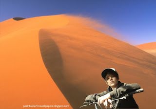 Wallpaper of Justin Bieber Riding Bicycle at Desert Wind desktop wallpaper