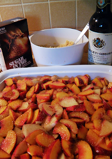 Sliced Nectarines with Bottle of Sherry, Raw Sugar box, and Crumble Topping