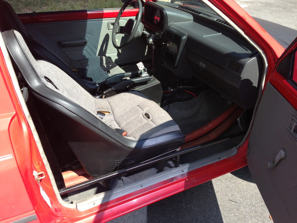 Inside The Cabin Is All Business It Should Be Really Loud And While Fixed Sport Seats Look Relatively Comfortable Exposed Silicone Coolant