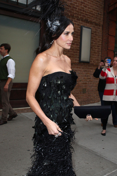 Demi Moore in a dramatic black, feathered strapless Prabal Gurung gown and a matching feathered Philip Treacy headpiece.