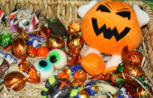 Halloween sweets and stuffed pumpkin