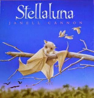 Book cover: Stellaluna by Janell Cannon. Image depicts a bat clumsily tangled among tree branches while two birds fly by in the background.