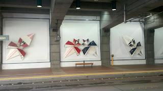 Paper Chase art in International District Transit Tunnel Station