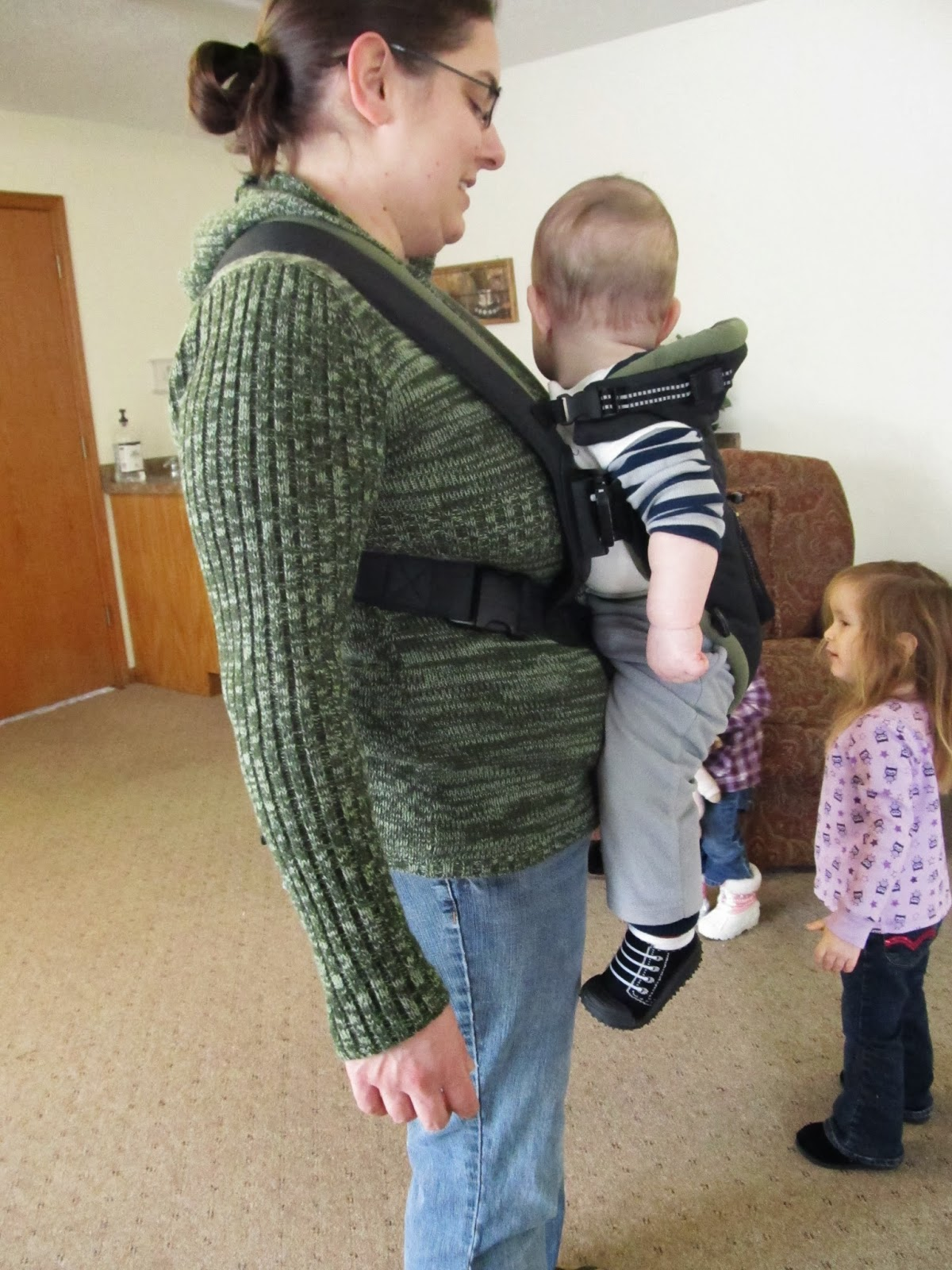 "Narrow based baby carriers or ""front packs "" such as the popular Baby Bjorn are controversial in the baby wearing world"