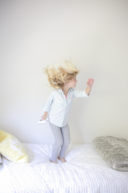 Amy West's daughter jumping on bed