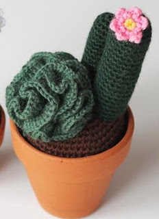 http://www.craftsy.com/pattern/crocheting/home-decor/curly-cactus-english/57612