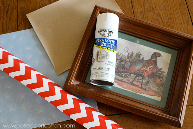 An old frame, some spray paint and some scrapbook paper are all you need to make a patriotic USA Flag Picture Tray!