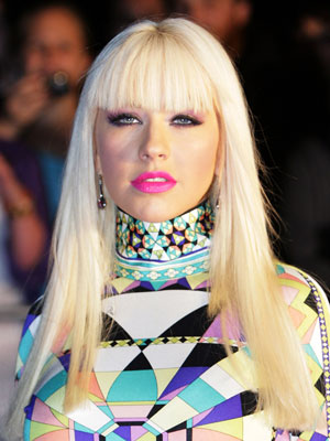 Christina Aguilera's super-smooth, ultra-long hairstyle is topped off with sexy, chipped-into bangs.