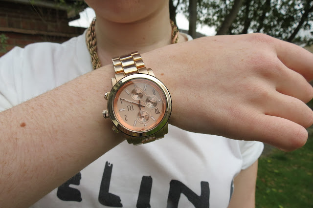 a photo of rose gold river island watch like michael kors dupe
