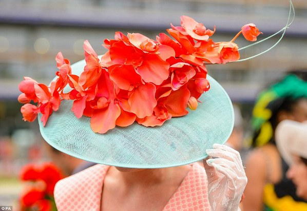 oversized turquoise hat with coral flowers on Ladies' Day of Royal Ascot 2014